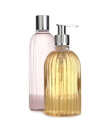 Stylish bottles with cosmetic products on white background