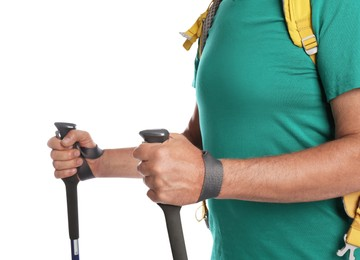 Male hiker with backpack and trekking poles on white background, closeup