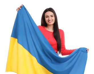 Young woman with flag of Ukraine on white background