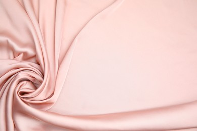 Texture of delicate pink silk as background, top view