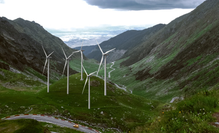 Alternative energy source. Wind turbines and mountains outdoors