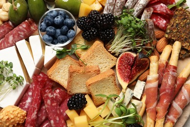 Different tasty appetizers as background, top view