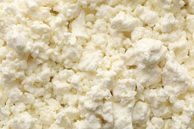 Delicious fresh cottage cheese as background, top view