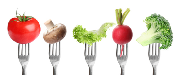 Forks with different vegetables on white background, banner design. Healthy meal