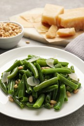 Tasty salad with green beans served on light grey table