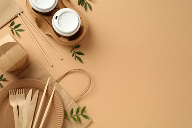 Flat lay of eco friendly products on beige background, space for text
