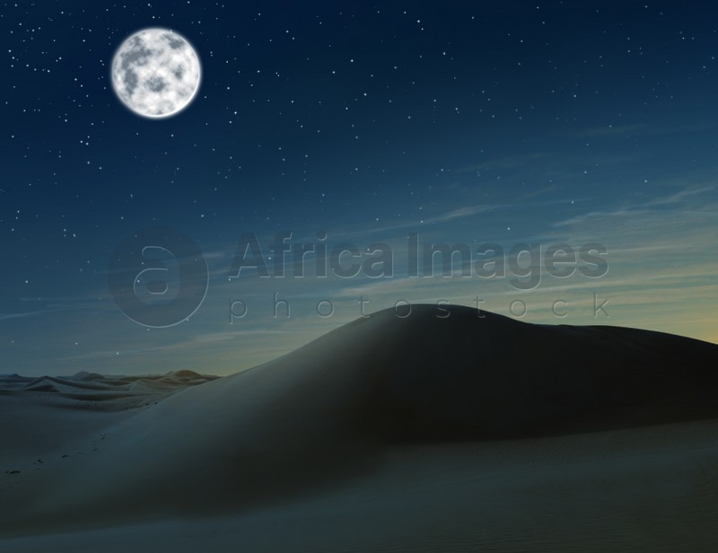 Scenic view of sandy desert under starry sky with full moon in night