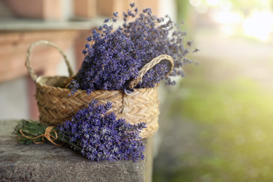 Beautiful lavender flowers and wicker basket outdoors