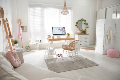 Stylish home office interior with sofa and comfortable workplace