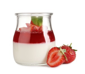Delicious panna cotta with strawberry coulis and fresh berries on white background