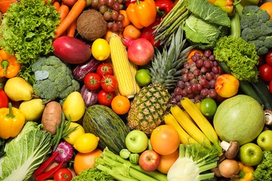 Assortment of organic fresh fruits and vegetables as background, closeup