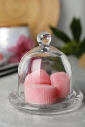 Glass cloche with delicious mochi on grey table. Traditional Japanese dessert