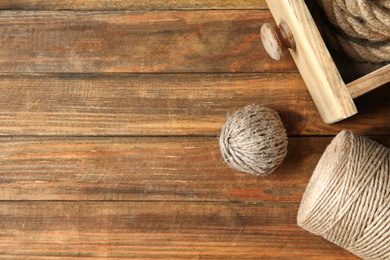 Flat lay composition with natural hemp ropes and space for text on wooden background