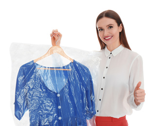 Young woman holding hanger with dress on white background. Dry-cleaning service