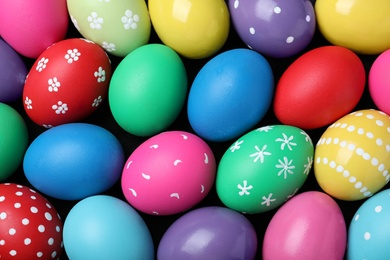 Colorful eggs as background, top view. Happy Easter
