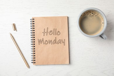 Start your week with good mood. Notebook with text Hello Monday, cup of coffee and pen on white wooden table, flat lay