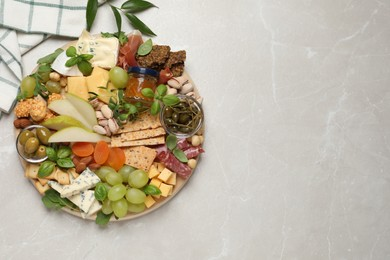 Different tasty appetizers on light table, flat lay. Space for text