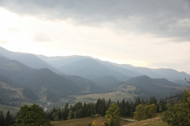 Picturesque view of beautiful mountains with conifer forest and village