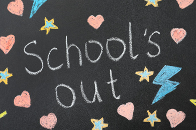 Words School's Out and pictures on blackboard. Summer holidays