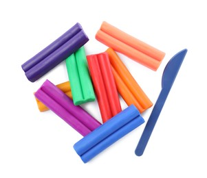 Many different colorful plasticine pieces and sculpting knife on white background, top view