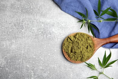 Hemp protein powder and fresh leaves on light grey table, flat lay. Space for text