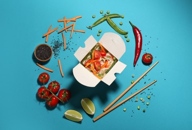 Box of vegetarian wok noodles with ingredients and chopsticks on turquoise background, flat lay