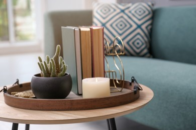 Stylish tray with different interior elements on wooden table in room