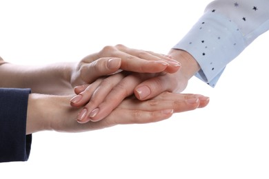 Women holding hands together on white background, closeup