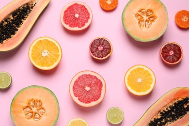 Different exotic fruits on pink background, flat lay