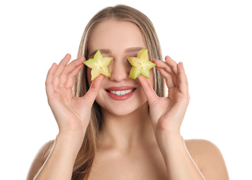 Young woman with cut carambola on white background. Vitamin rich food