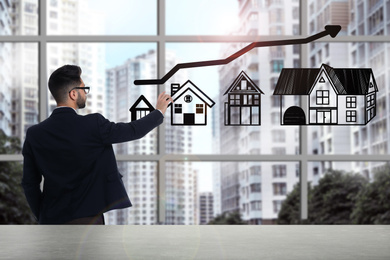 Real estate agent demonstrating prices at housing market. Man pointing on graph illustration