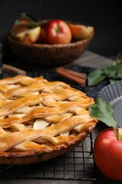 Delicious traditional apple pie on table, closeup