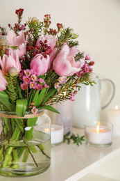 Beautiful bouquet with spring pink tulips on shelf