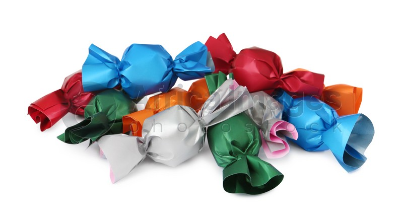 Many candies in colorful wrappers on white background
