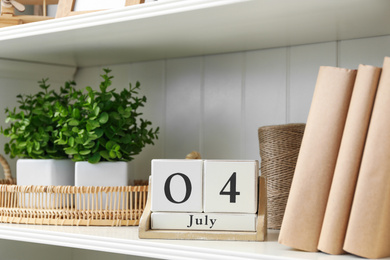 White shelving unit with calendar and decorative elements