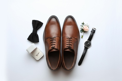 Composition with wedding shoes for groom on white background, top view