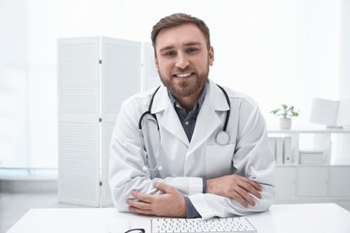 Pediatrician consulting patient using video chat in clinic, view from webcam
