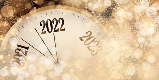 Clock counting last moments to New 2022 Year and beautiful fireworks on background, banner design