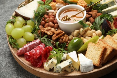 Different tasty appetizers on grey table, closeup
