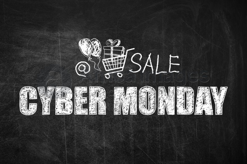 Text Cyber Monday Sale and picture of shopping cart on blackboard