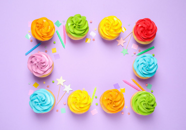 Colorful birthday cupcakes on lilac background, flat lay. Space for text