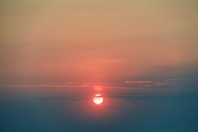 Picturesque view of sky with sun at sunset