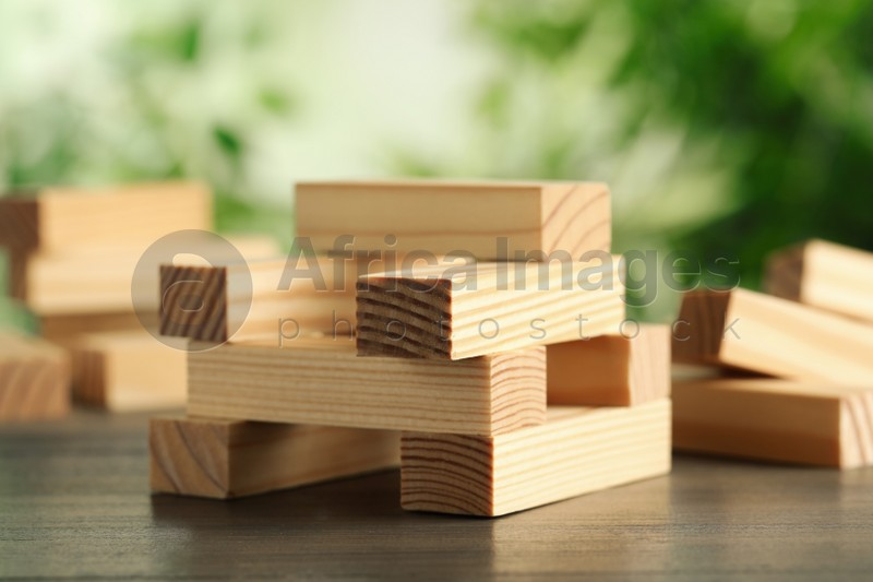 Wooden blocks on table outdoors. Jenga game