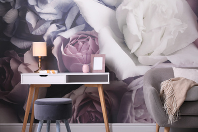 Beautiful room interior with stylish furniture and floral pattern on wall