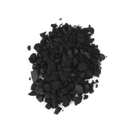 Pile of crushed activated charcoal pills on white background, top view. Potent sorbent