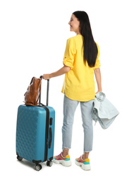 Beautiful woman with suitcase for summer trip on white background, back view. Vacation travel