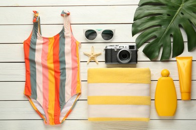 Flat lay composition with beach objects on white wooden background