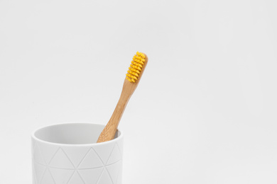 Bamboo toothbrush in holder isolated on white