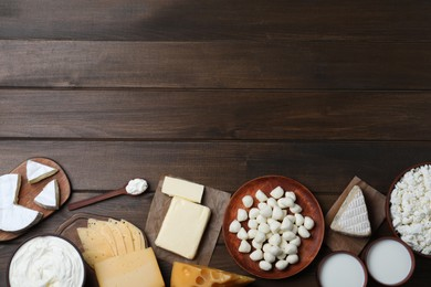 Flat lay composition with dairy products on wooden table. Space for text