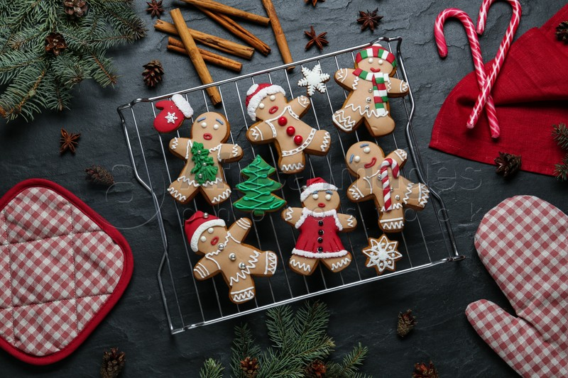 Flat lay composition with delicious Christmas cookies on black table